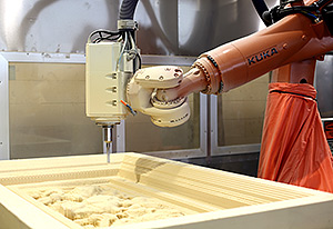 The KR QUANTEC extra HA milling one of the test pieces made of foam